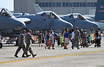 """(Chicopee, MA, 07/15/18) Members of the military and aviation enthusiasts walk past a row of A-10 """"Warthogs"""" during the Great New England Air and Space Show at Westover Air Reserve Base in Chicopee on Sunday, July 15, 2018. Photo by Christopher Evans"""