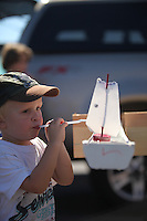 Pacific Beach, San Diego, CA, USA, Sunday October 10, 2010:  Children blow their homemade sailboats down the race course during PB Boy Scout Troop 246's annnual Raingutter Regatta Races at the First Baptist Church of PB on Mount Soledad Avenue.