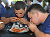 Anthony Catapano of Carey High School, left, and Matt Mascia of East Meadow participate in a chicken wing eating contest featuring the senior football all-stars from Long Island against their New York City counterparts at Hofstra University on Saturday, June 18, 2016. The teams will face each other on the gridiron in the 21st annual Empire Challenge at Hofstra on Tuesday, June 21.