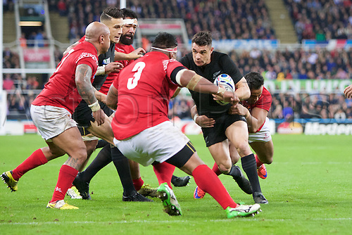 09.10.2015. St James Park, Newcastle, England. Rugby World Cup. New Zealand versus Tonga. New Zealand All Black fly-half Dan Carter hands off to Tonga prop Halani Aulika.