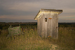 Wooden outhouse with small window, Second Wind Ranch, Sand Hills of Nebraska