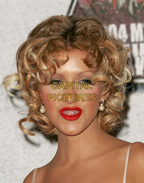CHRISTINA AGUILERA.Attends the 2004 Mtv Movie Awards held at The Sony Picture Studios in Culver City, California  .June 6, 2004.headshot, portrait, curls, red lipstick, highlights, hair, pearl earrings, tongue, funny face, poking tongue out.www.capitalpictures.com.sales@capitalpictures.com.©Capital Pictures