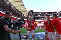 Liam Hogan of Salford City lifts the trophy in front of the Salford City fans during AFC Fylde vs Salford City, Vanarama National League Play-Off Final Football at Wembley Stadium on 11th May 2019