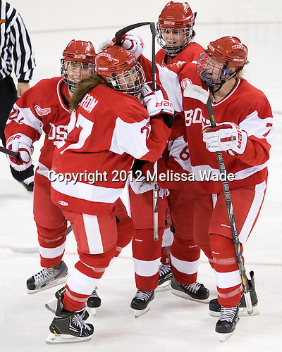 Isabel Menard (BU - 20), Jordan Juron (BU - 27), Louise Warren (BU - 28), Shannon Stoneburgh (BU - 7) - The visiting Boston University Terriers defeated the Boston College Eagles 4-2 on Friday, October 5, 2012, at Kelley Rink in Conte Forum in Chestnut Hill, Massachusetts.