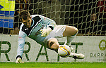 Mark Brown saves Nicky Law's spot kick to win the penalty shootout for Hibs