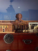 A collection of dog sculptures and a maquette of Nicolo's family home in Milan appear as if in an Egyptian landscape, placed in front of a photograph of a sphinx by Didier Massard