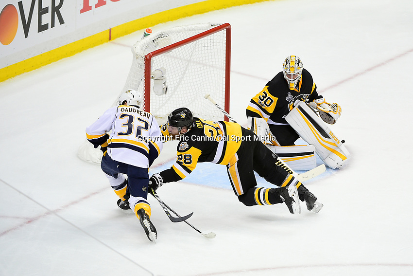 May 31, 2017: Pittsburgh Penguins defenseman Ian Cole (28) pushes Nashville Predators center Frederick Gaudreau (32) away form goalie Matt Murray (30) during game two of the National Hockey League Stanley Cup Finals between the Nashville Predators  and the Pittsburgh Penguins, held at PPG Paints Arena, in Pittsburgh, PA. The Penguins defeat the Predators 4-1 and lead the series 2-0. Eric Canha/CSM