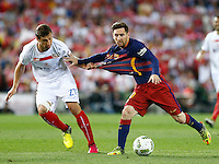 FC Barcelona´s Argentinean forward Lionel Messi and Sevilla´s midfielder Krychowiak during the Final of Copa del Rey match between FC Barcelona and SevillaFC at the Vicente Calderon Stadium in Madrid, Sunday, May 22, 2016.