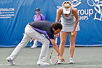 April 11, 2010:  MPS Group Championships.  Caroline Wozniacki (DEN) calls the head referee out to look at the mark on the court which was ruled out of bounds during finals singles action at the MPS Group Championships played at the Sawgrass Country Club in Ponte Vedra, Florida.  Caroline Wozniacki (DEN) defeated Olga Govortsova (BLR) 6-2, 7-5 to win the tournament for the second consecutive year..
