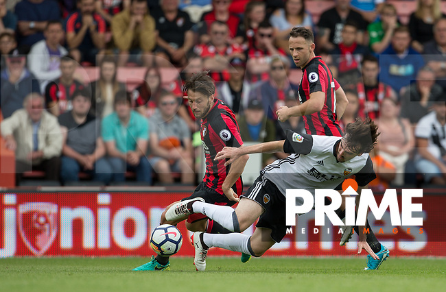 Harry Arter of Bournemouth & Eugeni Valderrama of Valencia during the Friendly match between Bournemouth and Valencia  at the Goldsands Stadium, Bournemouth, England on 30 July 2017. Photo by Andy Rowland.