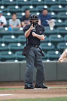 Home plate umpire Ben Phillips makes a strike call during the Carolina League game between the Buies Creek Astros and the Winston-Salem Dash at BB&T Ballpark on May 5, 2018 in Winston-Salem, North Carolina. The Dash defeated the Astros 6-2. (Brian Westerholt/Four Seam Images)