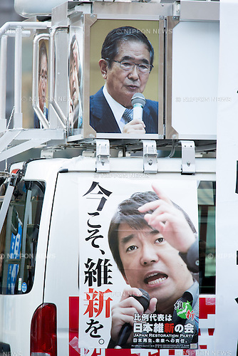 December 9, 2012, Tokyo, Japan - The campaign vehicle is adorned with election posters of former Tokyo Gov. Shintaro Ishihara, top, and Toru Hashimoto as the two top leaders of the Japan Restoration Party make a stumping stop at the Tokyo railroad station on Sunday, December 9, 2012, in their campaign for the December 16 general election. A recent poll showed the JRP founded by Osaka Mayor Hashimoto followed close behind the most favored Liberal Democratic Party led by former Prime Minister Shinzo Abe. (Photo by AFLO)