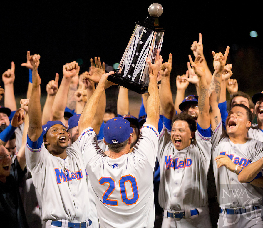 David Beach - Special to NWADG - Rockhounds begin celebrating their 7-0 victory over the Naturals to clinch the Texas League Championship at Arvest Ballpark, Springdale, AR on September 18, 2015.  Manager Ryan Christenson of the Rockhounds holds up the Texas League Championship trophy.