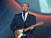 "08 August 2017 - Various - Glen Campbell, the voice behind 21 Top 40 hits including ""Rhinestone Cowboy,"" ""Wichita Lineman"" and ""By the Time I Get to Phoenix,"" died Tuesday. He was 81. During a career that spanned six decades, Campbell sold over 45 million records. In 1968, he outsold the Beatles. Campbell was married four times, and has five sons and three daughters. In the early 1980s, while battling alcoholism and cocaine addiction, Campbell made tabloid headlines with a 15-month, high-profile relationship with country singer Tanya Tucker, who was 22 years his junior. In 1981, he became a born-again Christian and in 1982 he married Kimberly Woollen, a Radio City Music Hall Rockette. In 2003, he was arrested for a hit-and-run, an incident that ended with him allegedly kneeing a police officer in the thigh right before he was released. Campbell pleaded guilty to extreme drunken driving and leaving the scene of an accident, and spent 10 days in jail. In 2011, Campbell, then 75, revealed that he was diagnosed with Alzheimer's disease. In June of that year, he announced he was retiring from music due to the disease. He released his final album of original music Ghost and embarked on a farewell tour with three of his children backing him. File Photo: Jun 04, 2003; Nashville, TN, USA; Singer GLEN CAMPBELL performing at CMT's 100 Greatest Songs of Country Music held at the Gaylord Entertainment Center. Photo Credit: Photo: Laura Farr/AdMedia"