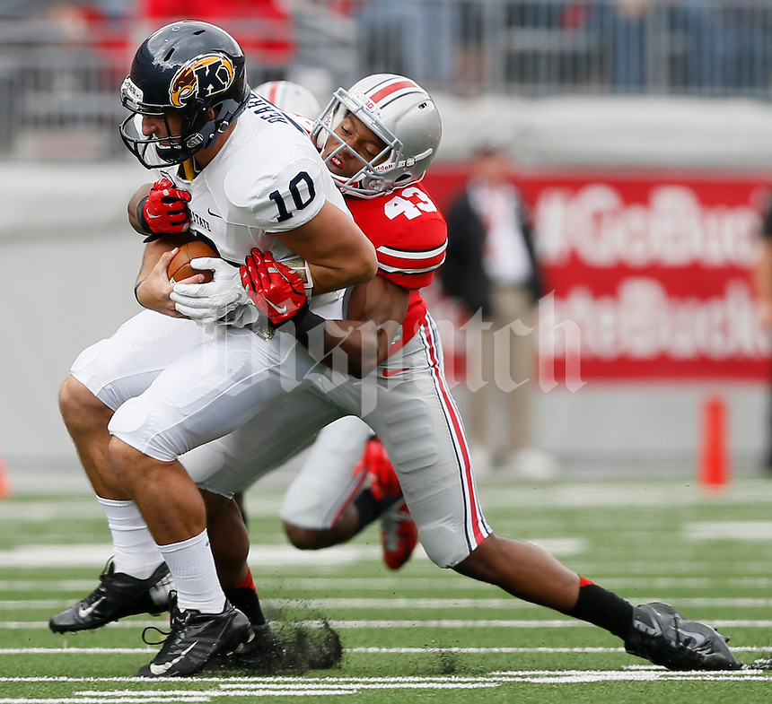 Kent State Golden Flashes quarterback Colin Reardon (10) is sacked by Ohio State Buckeyes linebacker Darron Lee (43) during Saturday's NCAA Division I football game at Ohio Stadium in Columbus on September 13, 2014. Ohio State won the game 66-0. (Dispatch Photo by Barbara J. Perenic)