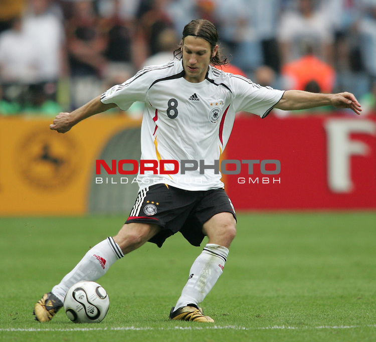 FIFA WM 2006 - Quarter-finals / Viertelfinale<br /> Play #57 (30-Jun) - Germany vs Argentina.<br /> Torsten Frings from Germany kicks the ball during the match of the World Cup in Berlin.<br /> Foto &copy; nordphoto
