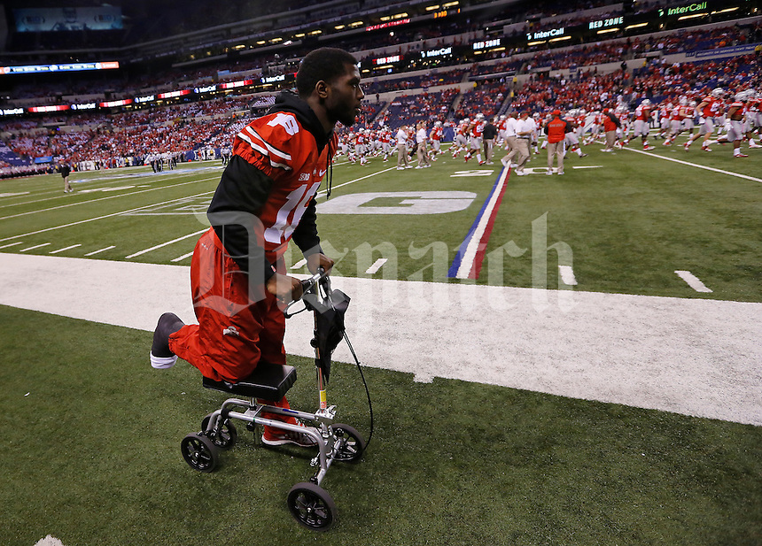 Ohio State Buckeyes quarterback J.T. Barrett (16) rolls toward the locker room with a broken ankle prior to the Big Ten Championship game against the Wisconsin Badgers at Lucas Oil Stadium in Indianapolis on Dec. 6, 2014. (Adam Cairns / The Columbus Dispatch)