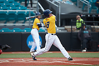Hogan Windish (18) of the UNCG Spartans follows through on his swing against the San Diego State Aztecs at Springs Brooks Stadium on February 16, 2020 in Conway, South Carolina. The Spartans defeated the Aztecs 11-4.  (Brian Westerholt/Four Seam Images)