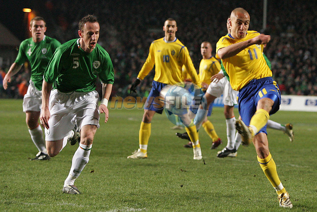 Dublin Ireland, Sweeden no 11 Henrik Larsson vies for the ball against the defence of the Irish during the friendly international match in Lansdowne Road Dublin 1/3/06..Photo EPA Aiden Crawley..(Photo credit should read EPA Photo/Aiden Crawley...This Picture has been sent you under the condtions enclosed by:.Newsfile Ltd..the Studio,.Millmount Abbey,.Drogheda,.Co Meath..Ireland..Tel: +353(0)41-9871240.Fax: +353(0)41-9871260.GSM: +353(0)86-2500958.email: pictures@newsfile.ie.www.newsfile.ie.FTP: 193.120.102.198..This picture is from Fran Caffrey@newsfile.ie