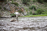USA, Wyoming, Encampment, an wrangler fly fishes for trout on the North Platte river