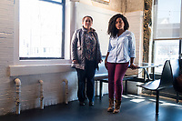 Isabel Lopez, 50, of Hyde Park, Boston, Massachusetts, (left) and Carlha Toussaint, 24, of Brockton, Massachusetts, are community organizers in the Brockton, Massachusetts, USA. Lopez, an immigrant from Honduras, is an independent community organizer who has worked with various organizations in the Brockton, Massachusetts, area for the past 8 years. Toussaint, an immigrant from Haiti, is an organizer with the Coalition for Social Justice. They are seen here in Jamaica Plain, Boston, Massachusetts.