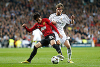 Real Madrid's Fabio Coentrao (r) and Manchester United's Shinji Kagawa during Champions League 2012/2013 match.February 12,2013. (ALTERPHOTOS/Alfaqui/Alex Cid-Fuentes)