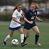 Alexandra Papa #5 of Port Washington, left, and Josephine Alliano #22 of Massapequa battle for control during first half of a Nassau County varsity girls soccer game at Burns Park in Massapequa on Monday, Oct. 15, 2018. Massapequa won by a score of 3-0.