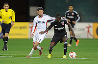 Washington, D.C.- March 29, 2014. Eddie Johnson (7) of D.C. United shields the ball against Lee Nguyen (24) of the New England Revolution.  D.C. United defeated the New England Revolution 2-0 during a Major League Soccer Match for the 2014 season at RFK Stadium.