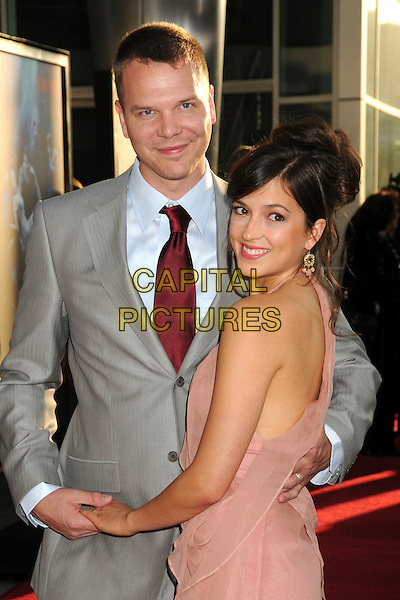 "JIM PARRACK & CIERA PARRACK.HBO's ""True Blood"" Season 3 Premiere held at Arclight Cinemas Cinerama Dome, Hollywood, California, USA..June 8th, 2010.half length suit jacket tie shirt pink dress holding hands looking over shoulder married husband wife red blue grey gray.CAP/ADM/BP.©Byron Purvis/AdMedia/Capital Pictures."