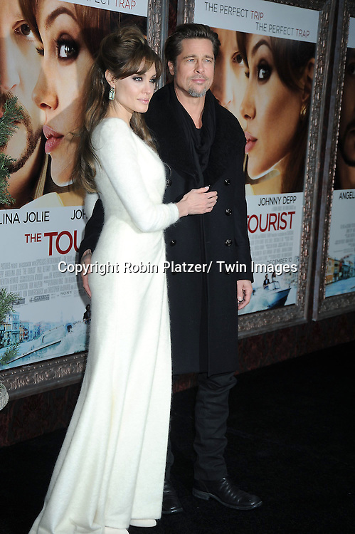 """Angelina Jolie and Brad Pitt at The World Premiere of """"The Tourist"""" on December 6, 2010 at The Ziegfeld Theatre in New York City. The film stars Angelina Jolie and Johnny Depp."""
