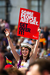 "© Joel Goodman - 07973 332324 - all rights reserved . 03/07/2010 . London , UK . A woman carrying a Stonewall placard reading "" Some People are Gay Get over it "" in Trafalgar Square . Annual London Pride march and demonstration through the centre of London . Photo credit : Joel Goodman"