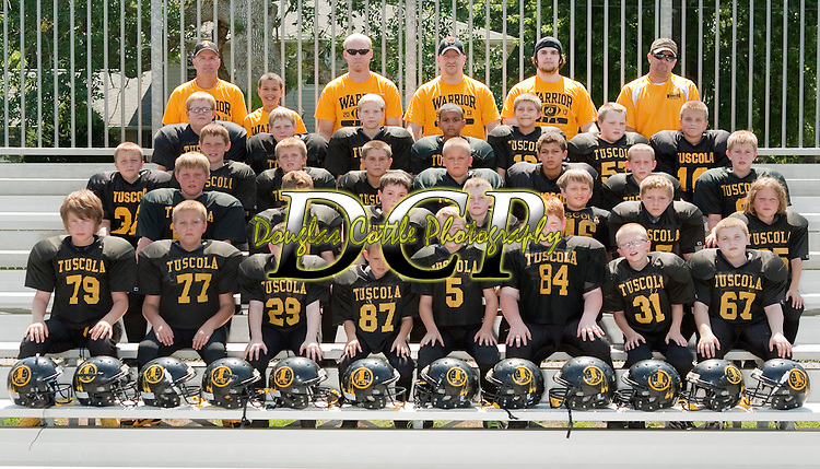 August 25, 2013- Tuscola, IL- The 2013 Tuscola JFL B-Team. Front row from left are Hans Goodman, Preston Brown, Cory Smith, Jayden Gaines, Caden Baer, Colton Gunther, Douglas Ruggles, and George Rahn. Second row from left are Kyler Skaggs, Colby Wilson, Zach Sutherlin, Landon Banta, Kaleb Miller, Jalen Southard, and Andrew Penne. Third row from left are Dylan Homman, Creed Yets, Chase Jones, Patrick Pierce, Blake Cruzan, Jalen Quinn, James Parsley, and Tytus Rennert. Fourth row from left are A.J. Laubscher, Mark Boyd, James Boyd, Michael Jones, Gavin Weber, Dylan Price, and Mason Holmes. Top row from left are Kevin Quinn, Jordan Quinn, John Boyd, Lonnie Homman, Trace Quinn, and Pat Pierce. [Photo: Douglas Cottle]