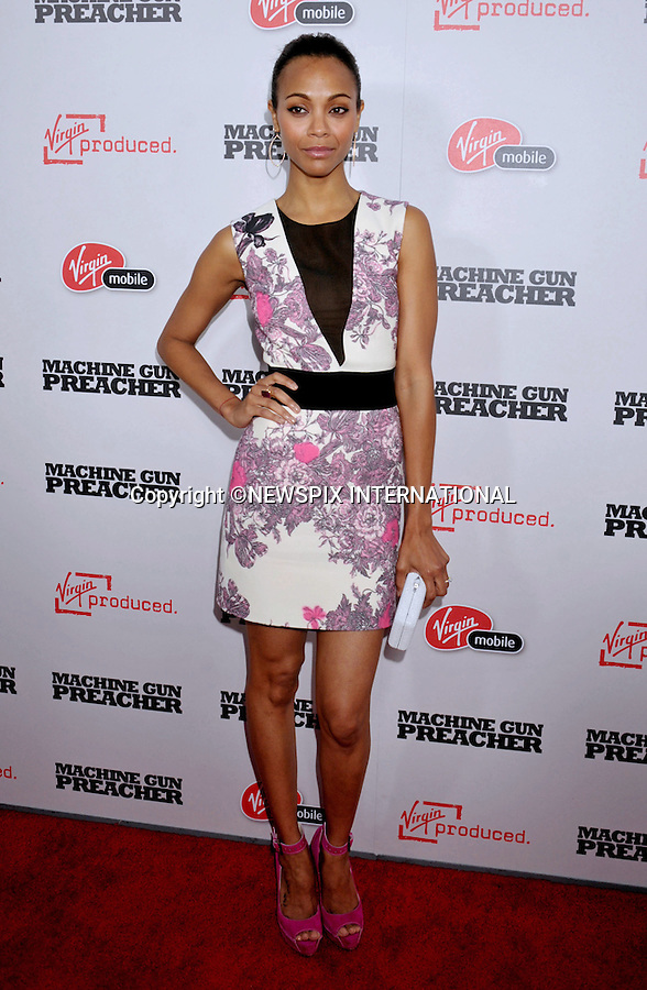 """ZOE SALDANA.attends Premiere of """"Machine Gun Preacher"""" at the Academy Theatre, Beverly Hills, Los Angeles_21/09/2011.Mandatory Photo Credit: ©Crosby/Newspix International. .**ALL FEES PAYABLE TO: """"NEWSPIX INTERNATIONAL""""**..PHOTO CREDIT MANDATORY!!: NEWSPIX INTERNATIONAL(Failure to credit will incur a surcharge of 100% of reproduction fees).IMMEDIATE CONFIRMATION OF USAGE REQUIRED:.Newspix International, 31 Chinnery Hill, Bishop's Stortford, ENGLAND CM23 3PS.Tel:+441279 324672  ; Fax: +441279656877.Mobile:  0777568 1153.e-mail: info@newspixinternational.co.uk"""