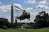 Marine 1, with United States President Barack Obama aboard, arrives at the White House from Camp David on August 4, 2013.<br /> Credit: Dennis Brack / Pool via CNP