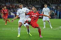 Cardiff City Stadium, Cardiff, South Wales - Tuesday 12th Aug 2014 - UEFA Super Cup Final - Real Madrid v Sevilla - <br /> <br /> Real Madrid&rsquo;s Pepe battles with Sevilla&rsquo;s Carlos Bacca<br /> <br /> <br /> <br /> <br /> Photo by Jeff Thomas/Jeff Thomas Photography