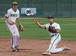 "Manogue's CJ Hires flips the ball to first from one knee after making a diving stop against Reno in the NIAA 4A Northern Regional Baseball Championship ""if game"" at Galena High School in Reno, Nevada on Saturday, May 12, 2018."