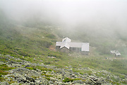 Appalachian Trail - Madison Hut on a foggy summer day from Mount Madison in the White Mountains, New Hampshire.