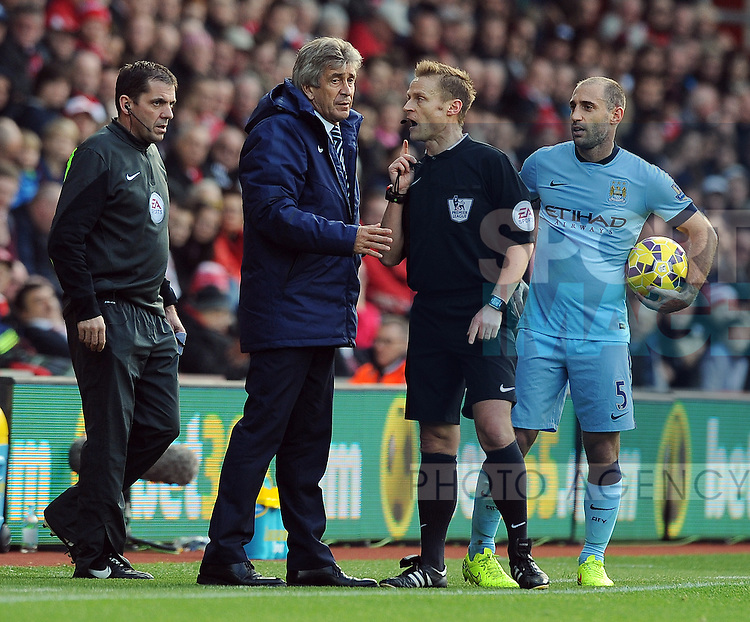 Manchester City manager Manuel Pellegrini is spoken to by referee Mike Jones<br /> - Barclays Premier League - Southampton vs Manchester City - St Mary's Stadium - Southampton - England - 30th November 2014 - Pic Robin Parker/Sportimage