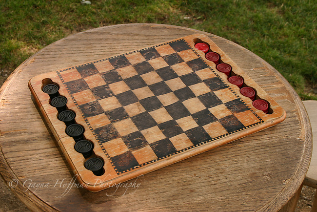 Antique wooden checkerboard game.