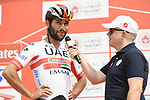 Fernando Gaviria (COL) UAE Team Emirates talks to Anthony McCrossan at sign on before the start of Stage 2 of the 2019 UAE Tour, running 184km form Yas Island Yas Mall to Abu Dhabi Breakwater Big Flag, Abu Dhabi, United Arab Emirates. 25th February 2019.<br /> Picture: LaPresse/Fabio Ferrari | Cyclefile<br /> <br /> <br /> All photos usage must carry mandatory copyright credit (© Cyclefile | LaPresse/MFabio Ferrari)