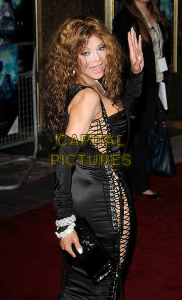 "LA TOYA JACKSON .Attending the UK film premiere of ""The Imaginarium Of Doctor Parnassus"" at the Empire Leicester Square cinema, London, England, UK, October 6th 2009..Latoya half length black lace-up sides corset dress silver diamond bracelets sleeves arm warmers back looking over shoulder rear ass behind side .CAP/CAN.©Can Nguyen/Capital Pictures"