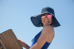Young brunette woman with  blue hair at the beach