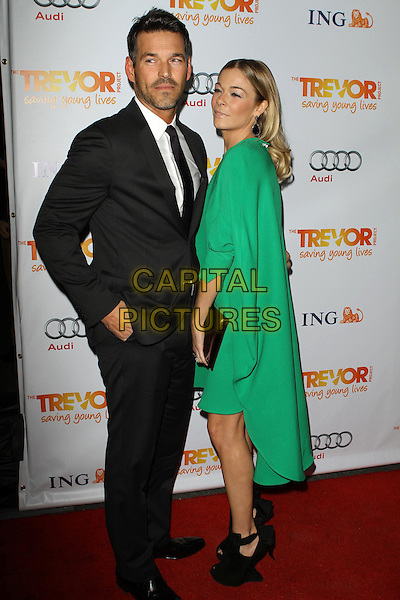 Eddie Cibrian and LeAnn Rimes.Trevor Live at The Hollywood Palladium in Hollywood, California, USA..December 4th, 2011.full length dress green clutch bag side black suit stubble facial hair couple shoes.CAP/ADM/KB.©Kevan Brooks/AdMedia/Capital Pictures.
