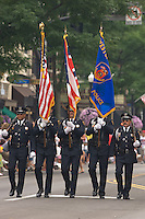 An honor guard leads the Fourth of July parade.