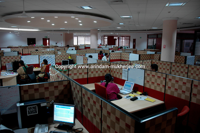 Indian people at work in Infosys, Bangalore. Infosys is the largest software company in the country and the head office is in Bangalore, Karnataka, India. Arindam Mukherjee