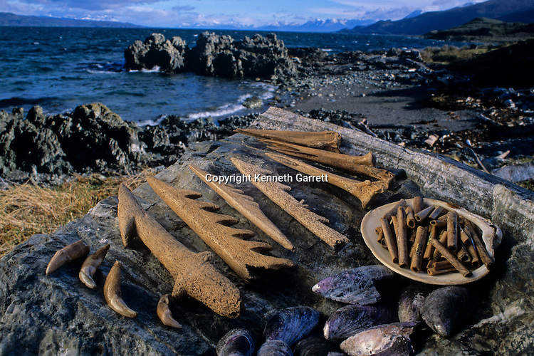 DOH; Who were the first Americans, Artifacts, 7000 R.C.D. from tunnel site at Beagle Channel, Tiera del Fuego, Chile, harpoons, bird-bone awls, tubular beads, mussel shells.