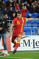 Cardiff City Stadium, Friday 11th Oct 2013. Aaron Ramsey of Wales taking a corner kick during the Wales v Macedonia FIFA World Cup 2014 Qualifier match at Cardiff City Stadium, Cardiff, Friday 11th Oct 2014. All images are the copyright of Jeff Thomas Photography-07837 386244-www.jaypics.photoshelter.com
