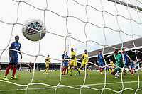 Josh Ruffels of Oxford United (2nd right) scores his team's third goal of the game to make the score 1-3 during the Sky Bet League 1 match between Peterborough and Oxford United at the ABAX Stadium, London Road, Peterborough, England on 30 September 2017. Photo by David Horn.