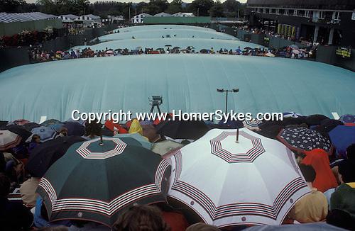 Tennis Wimbledon rain stops play.  The English Season published by Pavilon Books 1987