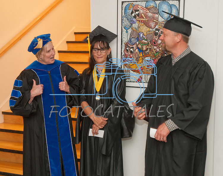 "WNC instructor Dr. Doris Dwyer, left, gives the ""thumbs up"" to graduating students Sylvia Doioron and Dave Hardin at the Western Nevada College commencement in Fallon, Nev., on Tuesday, May 20, 2014. Photo by Kim Lamb"